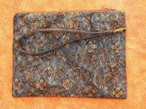 Orange, grey Batik printed clutch bag with leather wrist strap