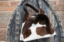 The Softy Tote in Brown and White Hair on Hide with coordinating brown purse