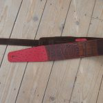 Art guitar strap in red and brown leather