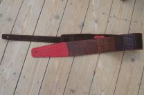 The Art guitar strap in red and brown leather